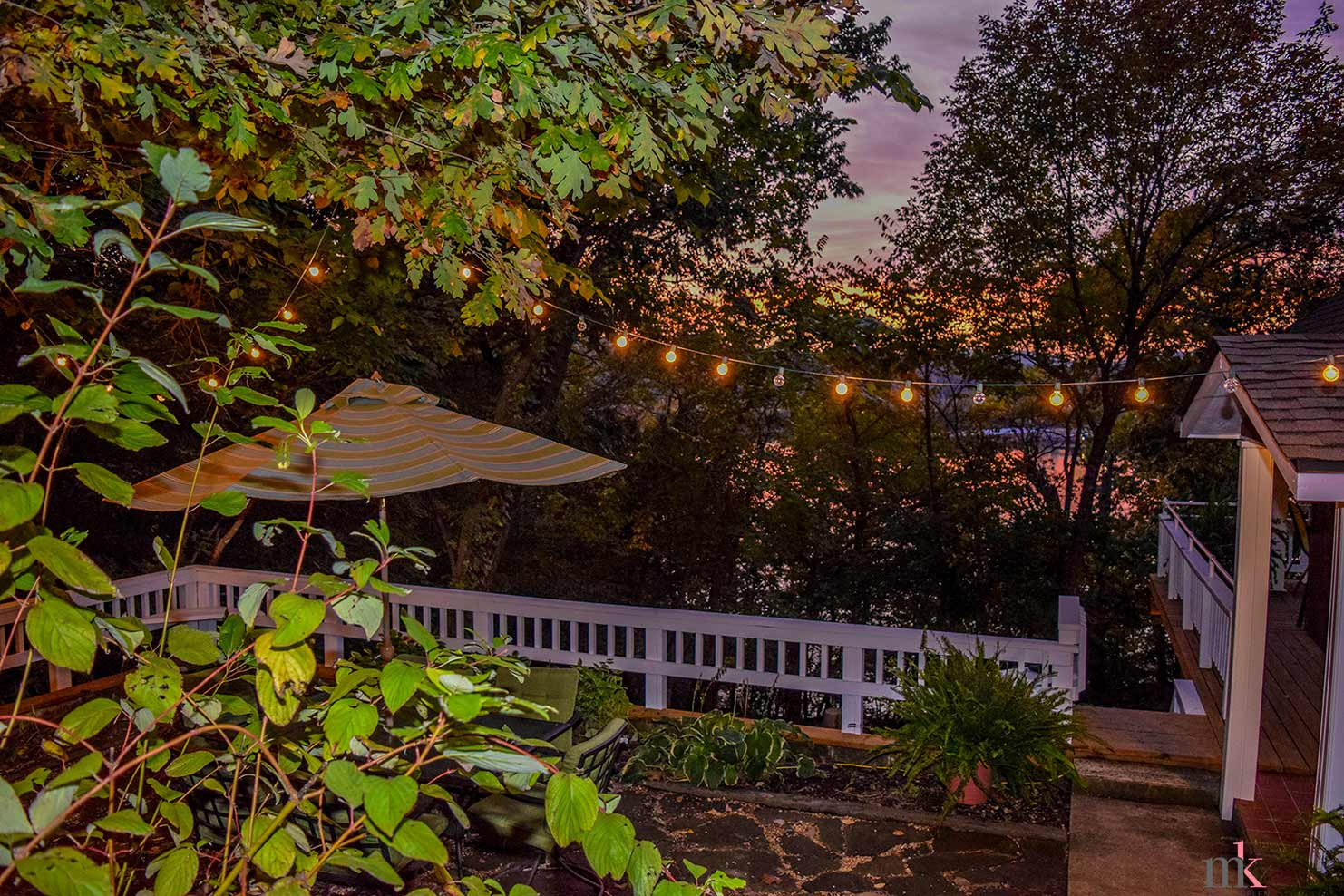 On The Rocks Cottage overlooking upper patio and Table Rock Lage at night with lights