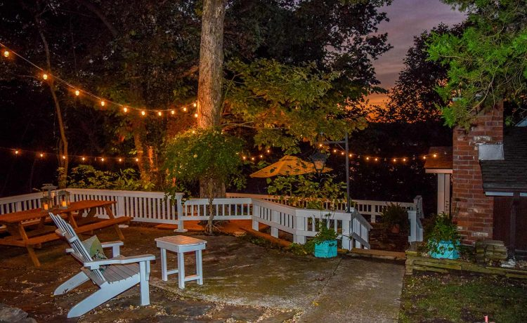 On The Rocks Cottage upper patio at night