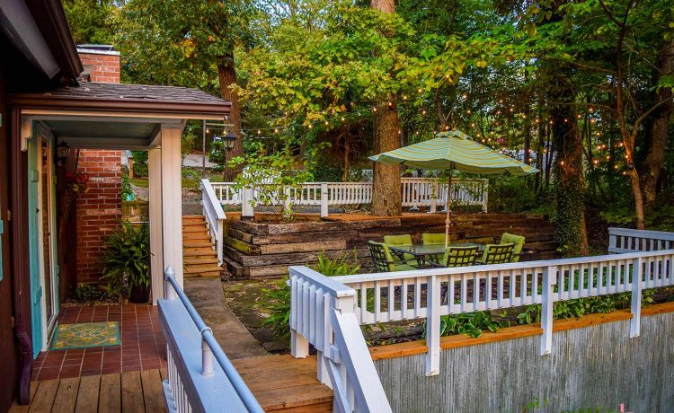 On The Rocks Cottage from covered deck onto entrance and upper patio