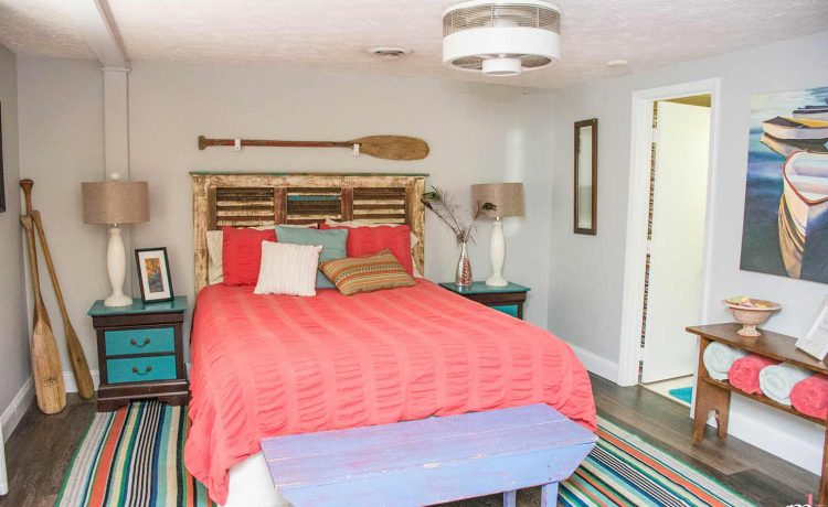 On The Rocks Cottage lake-view queen bedroom